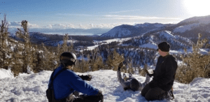 featured image three young men enjoying the view of Lake Tahoe while skiing on the mountain
