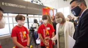 featured image showing Nevada Lt. Governor Kate Marshall and University of Nevada, Reno President Brian Sandoval visit with members of FYRE Robotics, a FIRST Robotics Competition team, at the K-12 Robotics Center opening event.