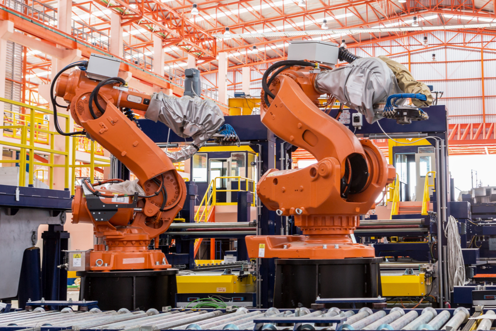 Featured image showing two industrial welding robots in a production line at a modern manufacturing factory